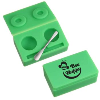 A picture of small, green silicone container set; inside are two spaces. HiRes image